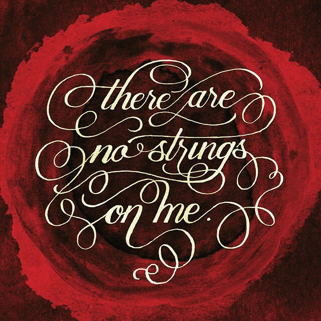 "Digital edit of the inked calligraphy, on a red grungy painted background. Calligraphy with swashes linking the words together, reading ""there are no strings on me."""
