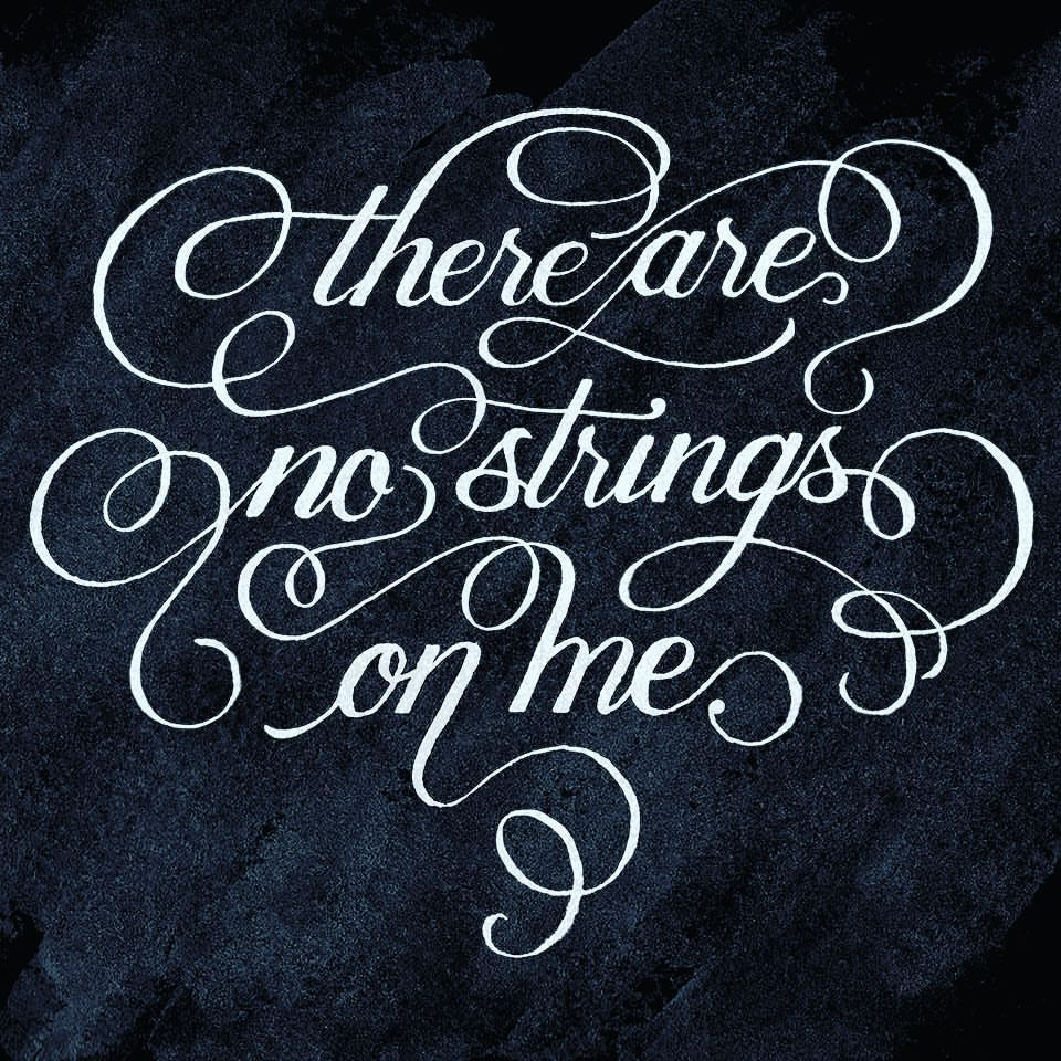 "Second digital edit of the inked calligraphy, on a blue grungy painted background. Calligraphy with swashes linking the words together, reading ""there are no strings on me."""